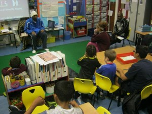 Children enjoying listening to a guest speaker in a classroom during SHOCK programme